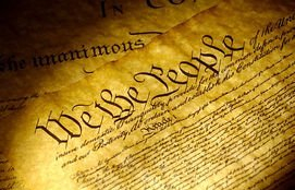 we-the-people-spot-light-on-the-declaration-of-independence-stock-photos_csp0141823-12121202407310817491.jpg